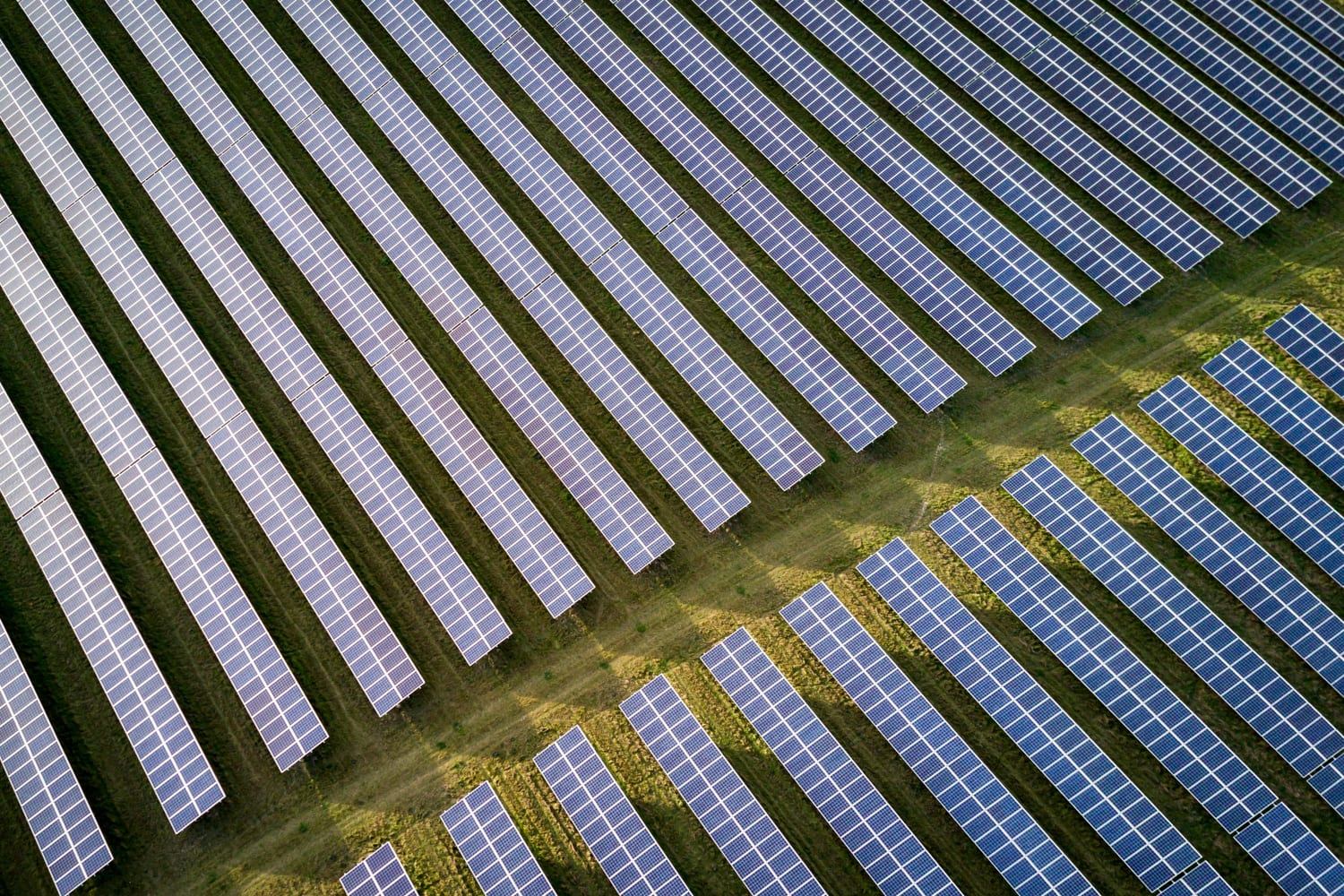 ground mounted solar project over green grass
